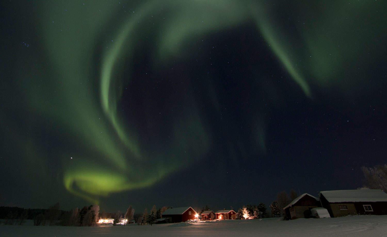 Northern Lights In Winter Over Gunnarsbyn In Råne River Valley. Photo By  Fredrik Broman.